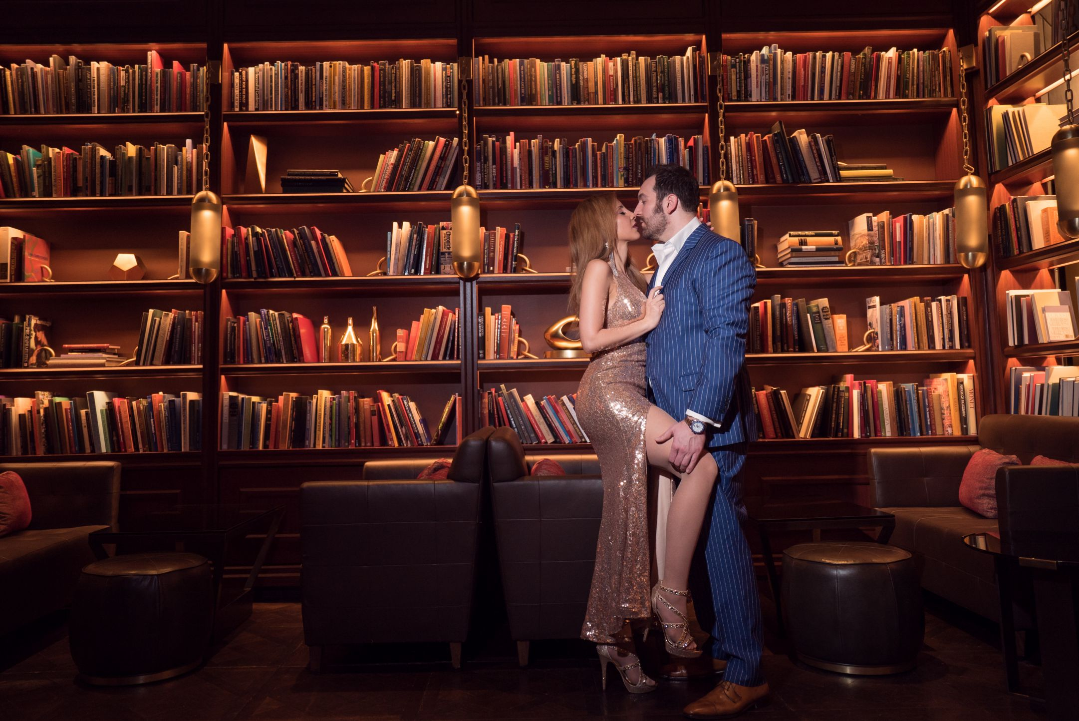 Couple photoshoot inside a library all dressed up