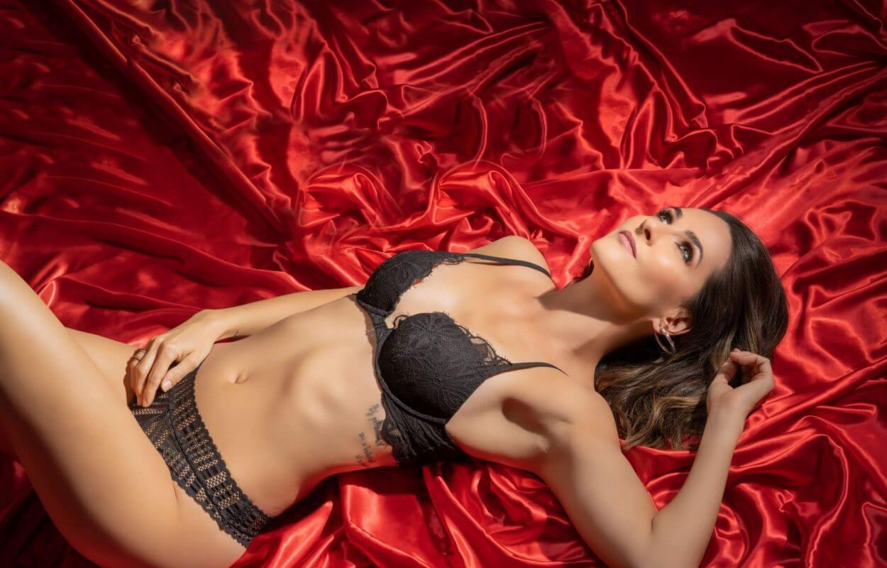 Boudoir photoshoot of women in black lingerie.