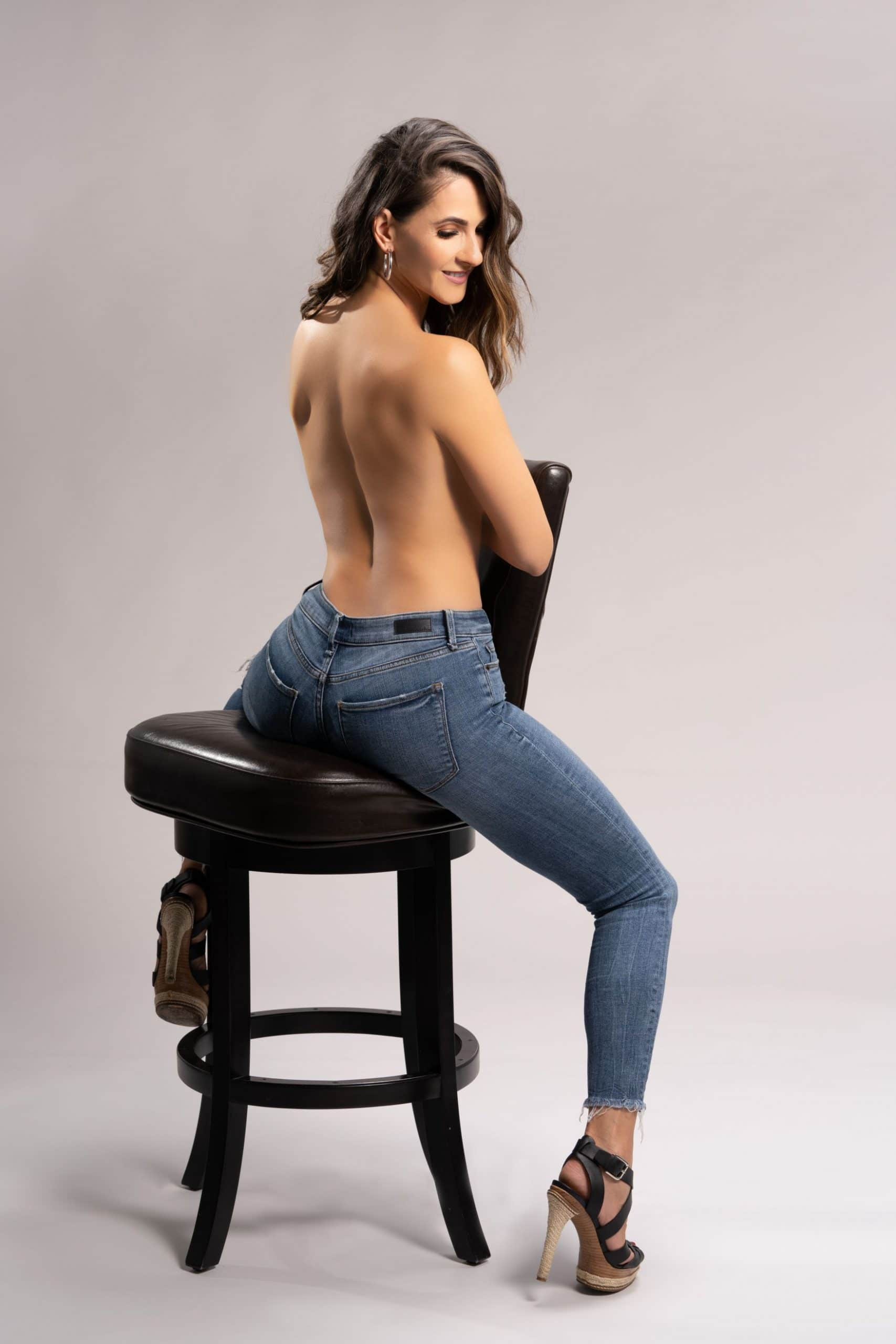 Strong woman photography of woman sitting across chair.